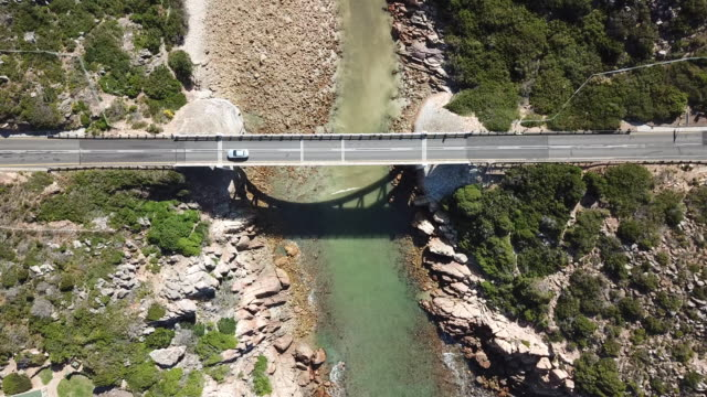 vehicle crossing the bridge over the ravine - tarmac stock videos & royalty-free footage