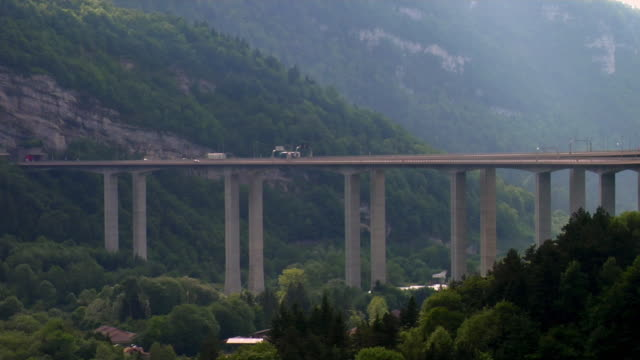 ws t/l vehicle crossing viaduct on l'autoroute blanche / nantua, rhone alps, france - viaduct stock videos & royalty-free footage