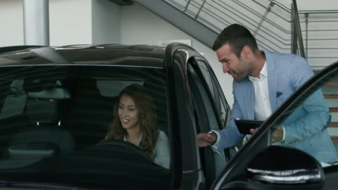 vehicle dealer showing young woman new car - opportunity stock videos & royalty-free footage