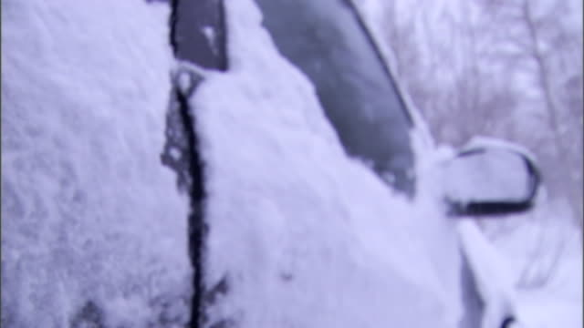 a vehicle door stands slightly ajar in a blizzard. - ajar stock videos & royalty-free footage
