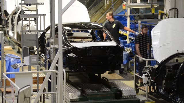 vehicle doors move along the production line at the volvo cars plant in torslanda sweden on thursday aug 22 an employee works on car doors volvo cars... - fahrgestell stock-videos und b-roll-filmmaterial