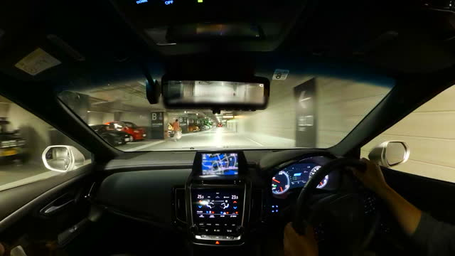 vehicle pov drive through underground parking garage. wide image view of driver pov - car park stock videos & royalty-free footage