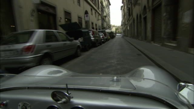 a vehicle drives through the narrow streets of florence. - tuscany stock videos & royalty-free footage