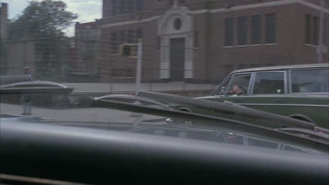 A vehicle drives through the streets of Brooklyn.