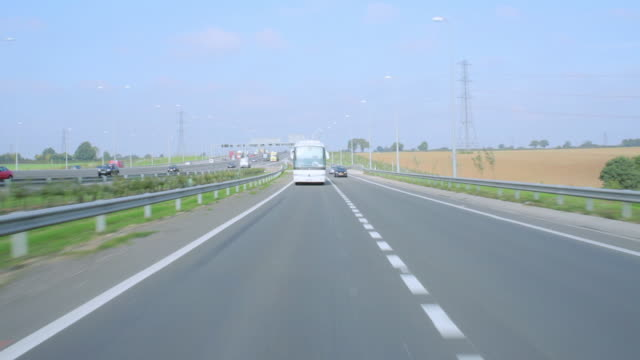 RPOV Vehicle driving down the busy M1 Motorway and merging onto another road / Hertfordshire, England, United Kingdom