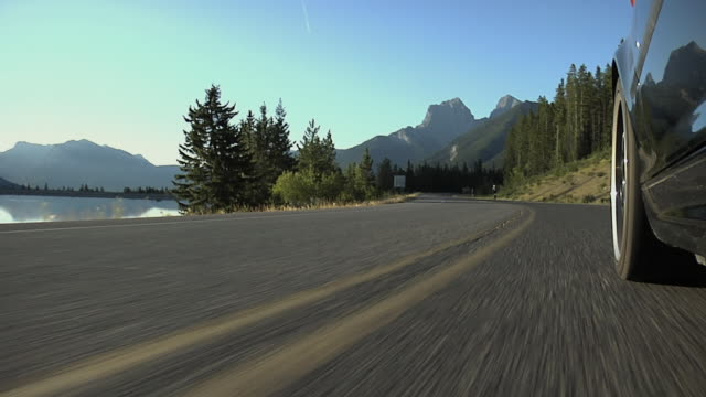 POV, LA, WS, vehicle driving on road with mountains in background, Canmore, Alberta, Canada