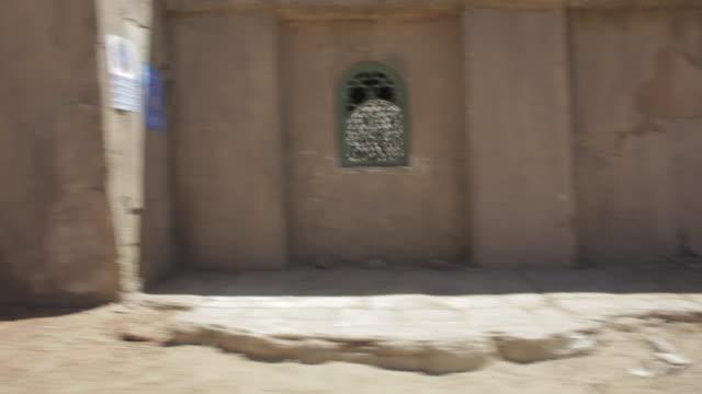 pov vehicle driving past structures on desert, rustic road / santa clarita, california, united states - santa clarita stock videos & royalty-free footage