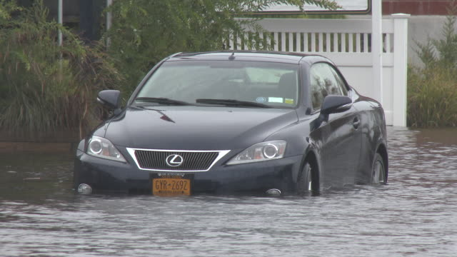A vehicle is partially submerged in storm surge flooding during a powerful nor'easter in the town of Riverhead New York
