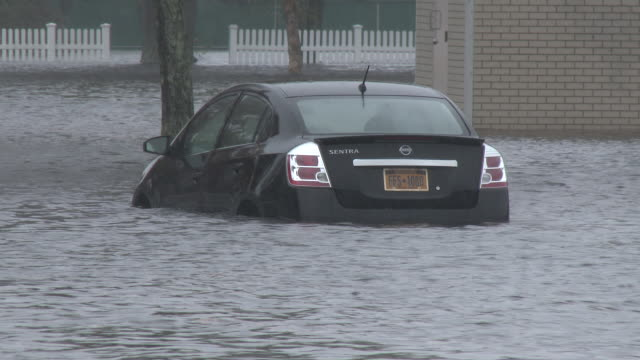 A vehicle is submerged in storm surge flooding during a powerful nor'easter in the town of Riverhead New York