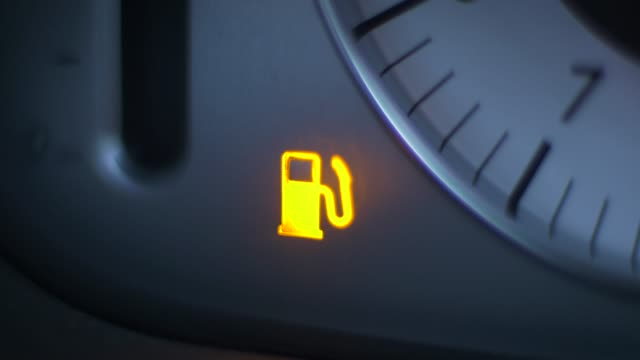 vehicle low fuel warning light illuminating - fuel pump stock videos and b-roll footage