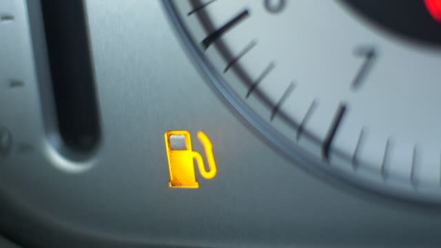 vehicle low fuel warning light illuminating - petrol stock videos & royalty-free footage
