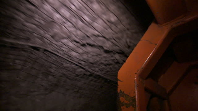 a vehicle moves through the shaft of a coal mine. - mine shaft stock videos and b-roll footage