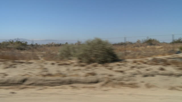 ws pov vehicle moving on desert highway / palmdale, california, usa    - palmdale stock videos and b-roll footage