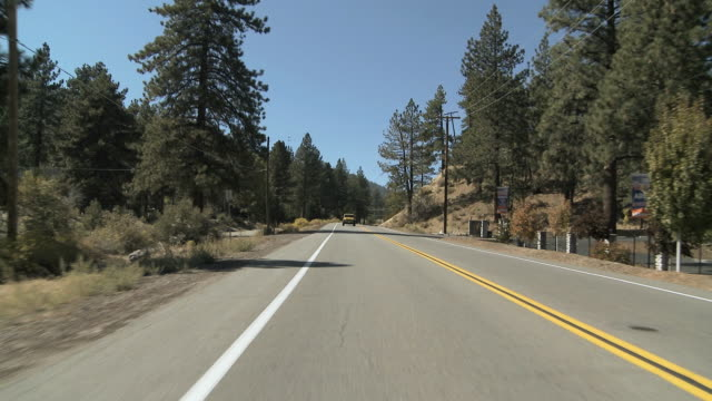WS POV Vehicle moving on two lane highway / Wrightwood, California, USA