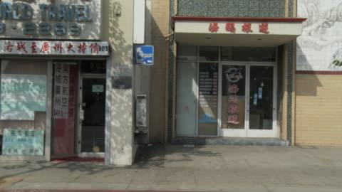 ws pov vehicle moving through chinatown / los angeles, california, usa - chinatown stock videos & royalty-free footage