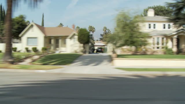 WS POV Vehicle moving through residential area on sunny day / Pasadena, California, USA