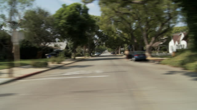 ws pov vehicle moving through shady leafy neighborhood / south pasadena, california, usa - pasadena california stock videos & royalty-free footage