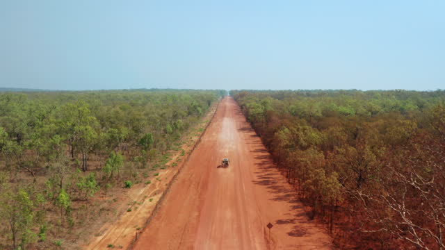 a vehicle on a remote outback dirt road - remote location stock videos & royalty-free footage