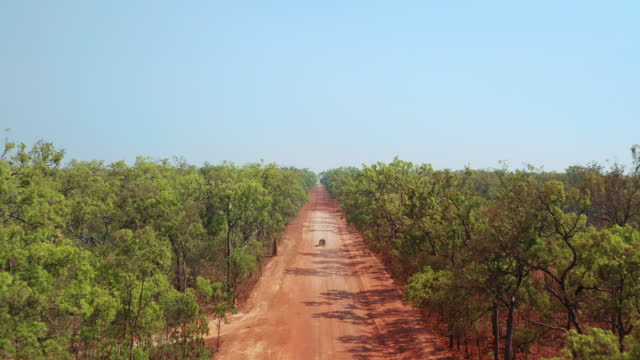 a vehicle on a remote outback dirt road - queensland stock videos & royalty-free footage