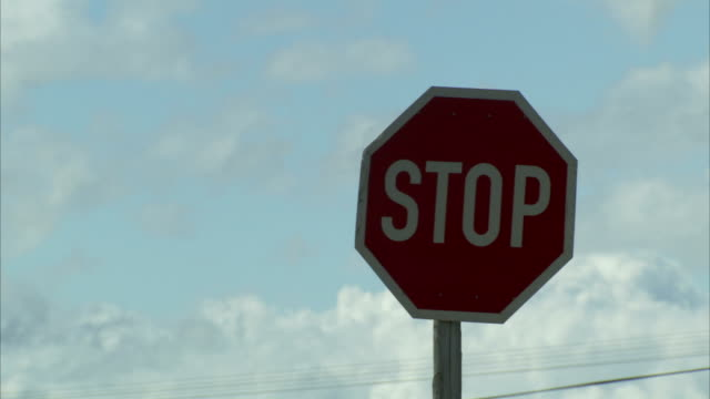A vehicle passes a stop sign.