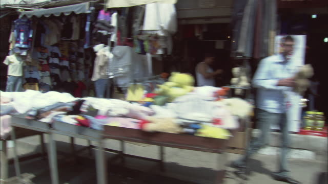 ws pov vehicle passing through shops and shoppers / shatila refugee camp, beirut, lebanon - 2006 stock videos and b-roll footage