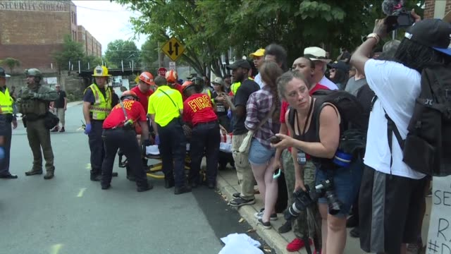A vehicle plows into a crowd of people at a Virginia rally where violence erupted between white nationalist demonstrators and counterprotesters...