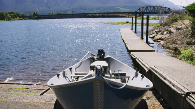 vehicle point of view shot of backing a small boat up down a boat ramp and into the columbia river in washington on a sunny day - boat ramp stock videos & royalty-free footage