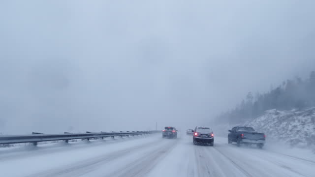 vehicle point of view shot of driving along interstate 70 in the rocky mountains of colorado in a snowstorm in winter - boundary stock videos & royalty-free footage
