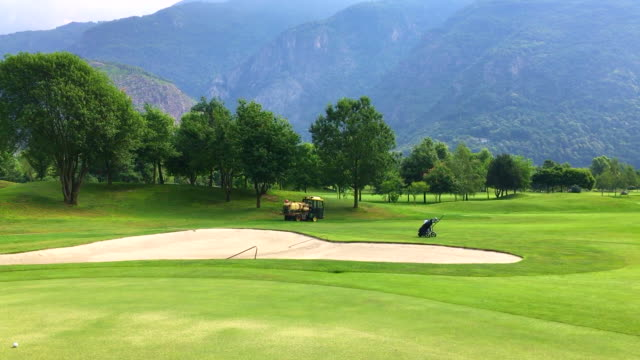 vehicle putting pesticide on golf course with mountain in losone ticino switzerland - herbicide stock videos & royalty-free footage