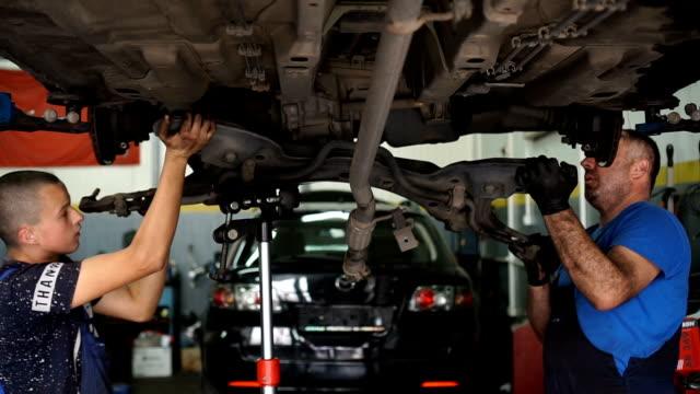 vehicle repair - slow mo - machine part stock videos & royalty-free footage