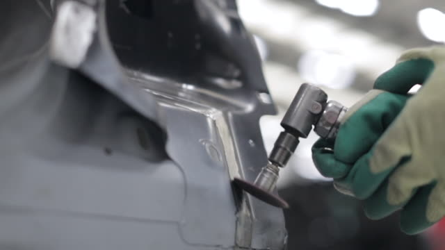 vehicle repair - using an air sander to clean the body surface - sander stock videos and b-roll footage
