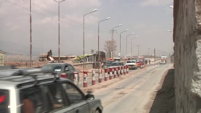 vehicle searches are conducted at the gates of kabul by the afghan national police under the guidance of the us police advising detachment from camp... - kabul stock videos & royalty-free footage