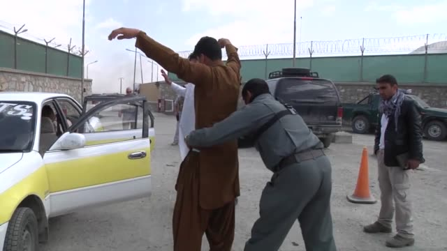 Vehicle searches are conducted at the Gates of Kabul by the Afghan National Police under the guidance of the US Police Advising Detachment from Camp...