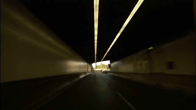 A vehicle speeds through two long tunnels in Sydney, Australia.