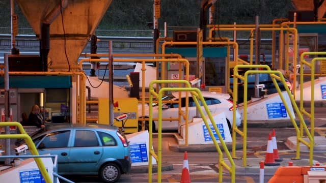 Vehicle stop at the tolls for the M48 Severn Bridge towards Wales from England along the motorway bridge link between England and Wales which was...