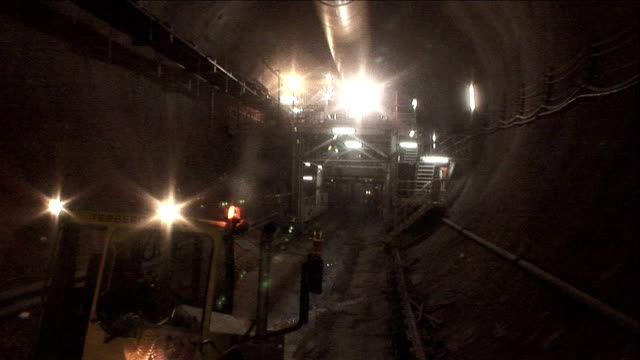 a vehicle tows a cement mixer through a tunnel at the niagara tunnel boring project. - cement mixer stock videos and b-roll footage