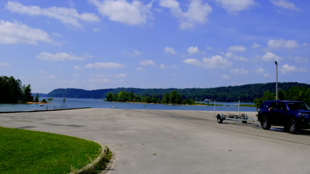 a vehicle tows an empty boat trailer at monroe lake's paynetown boat ramp sunday august 16 near bloomington indiana a car was driven into the lake... - boat ramp stock videos & royalty-free footage