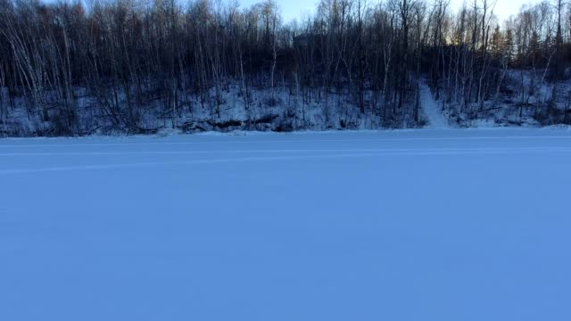 vehicle tracks on frozen lake - frozen stock videos and b-roll footage