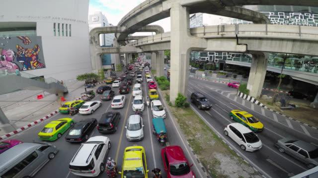vehicle traffic and motion at junction on road in bangkok - bangkok stock videos & royalty-free footage
