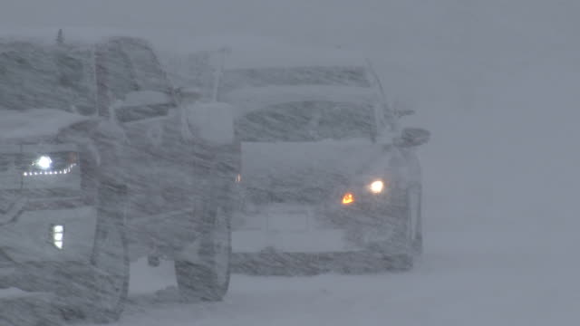 vehicle traffic in a blizzard - scott mcpartland stock videos & royalty-free footage