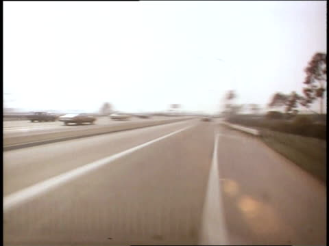 1975 pov vehicle traveling through traffic on freeway / queens, ny, united states - queens stock-videos und b-roll-filmmaterial
