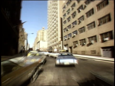 1975 montage vehicle traveling through traffic on freeway / queens, ny, united states - anno 1975 video stock e b–roll