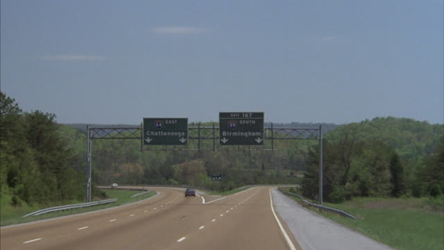 A vehicle travels down a highway in Alabama.