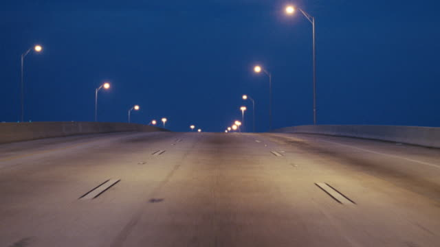 vidéos et rushes de a vehicle travels on an interstate highway toward miami, florida. - palmier