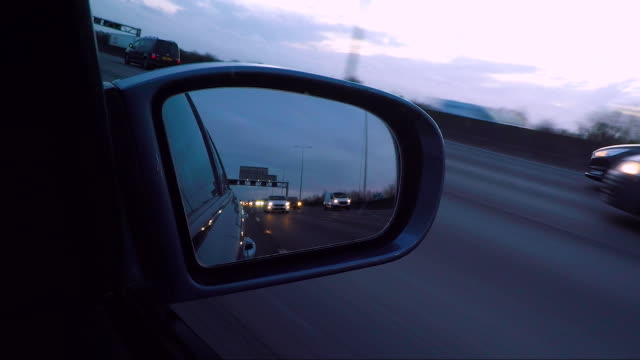 vehicle wing mirror on the motorway. - wing mirror stock videos & royalty-free footage