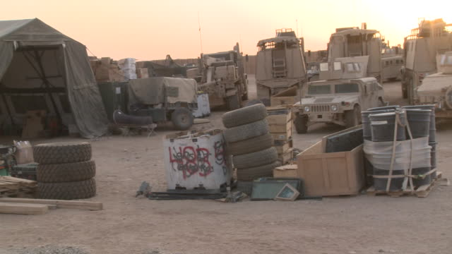 Vehicles and other materiel is staged at a U.S. Marine logistics base in Afghanistan.