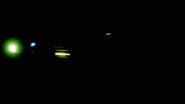 vehicles and their headlights and tail lights illuminate a road at night in fast motion - headlight stock videos & royalty-free footage