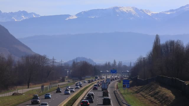 vehicles arrive at the chignin tollgate near chambery on the a43 highway leading to the french alps ski resorts on february 22 2020 in les marches... - ski resort stock videos & royalty-free footage