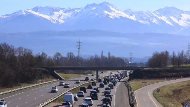 vidéos et rushes de vehicles arrive at the chignin tollgate near chambery on the a43 highway, leading to the french alps ski resorts on february 22, 2020 in les marches,... - embouteillage