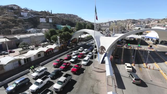 Vehicles cross from Mexico into the United States are checked by Office of Field Operation officers Homeland Security Agencies Work To Secure...